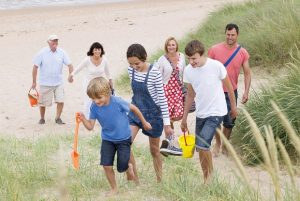 Family - children, parents and grandparents - on beach